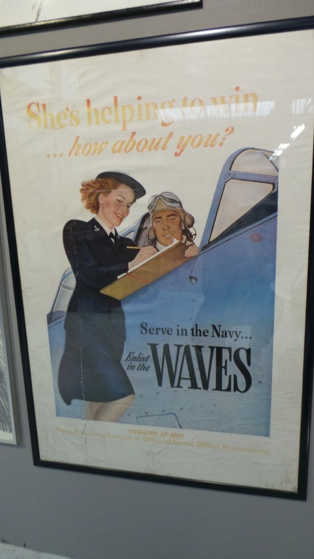 A WWII US naval recruitment poster ''She's hoping to