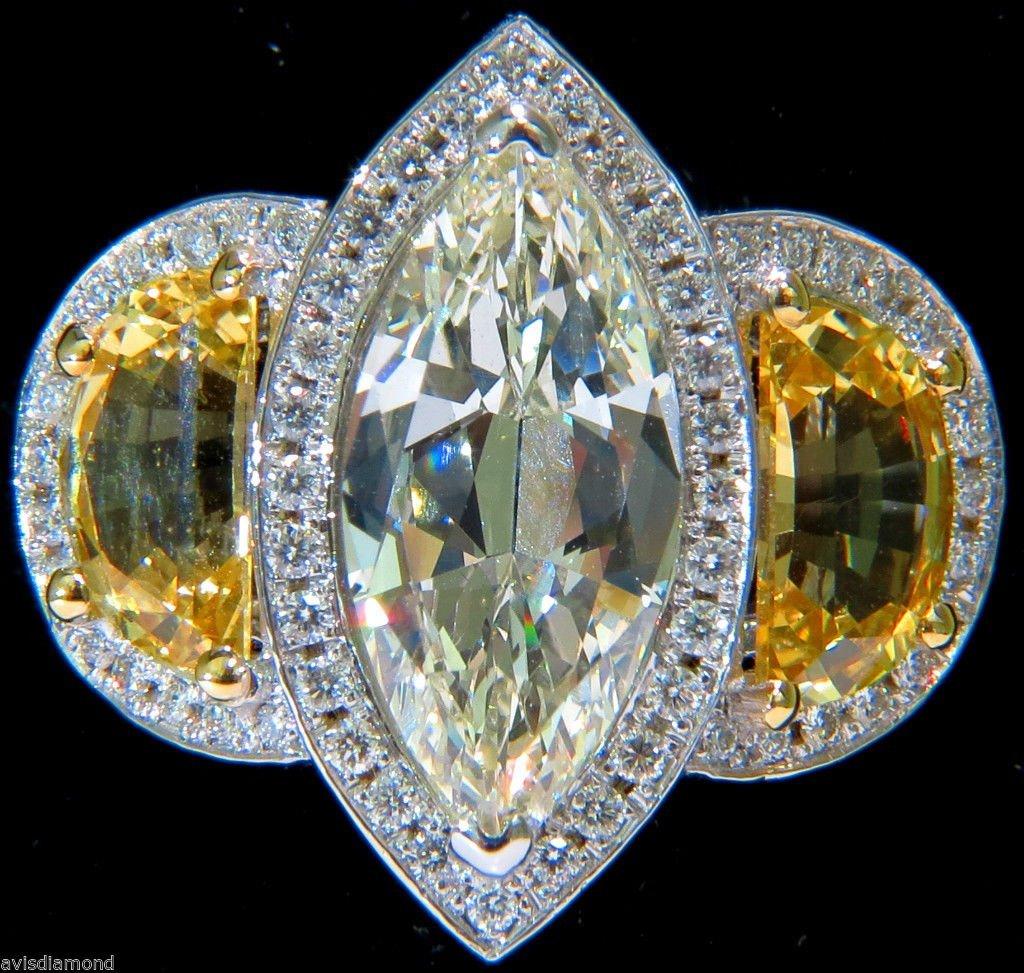 GIA 18KT 7.82CT MARQUISE DIAMOND YELLOW SAPPHIRE RING
