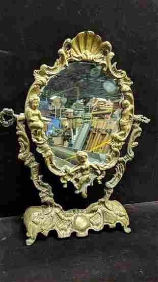Vintage Brass Swivel Mirror with Cherub design
