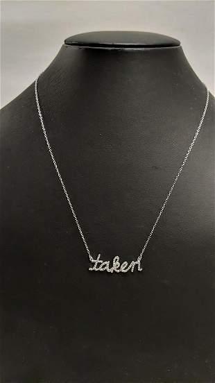 """Diamond """"Taken"""" necklace"""