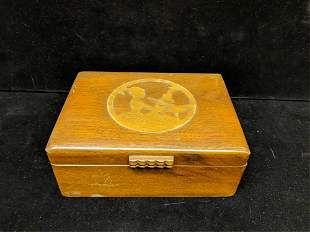 Vintage wood jewelry box with a silhouette on top
