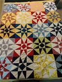 Vintage hand made star pieced quilt