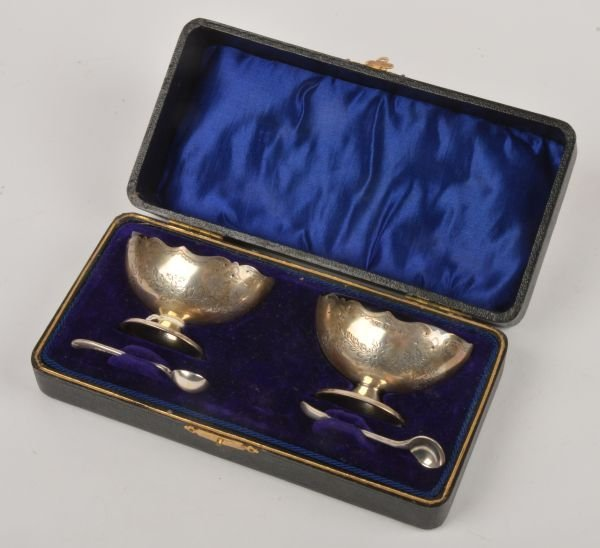 A pair of silver boat shaped salts by E J Houlston