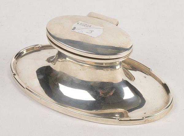 A silver oval inkwell by A.  J. Zimmerman Ltd., Bi