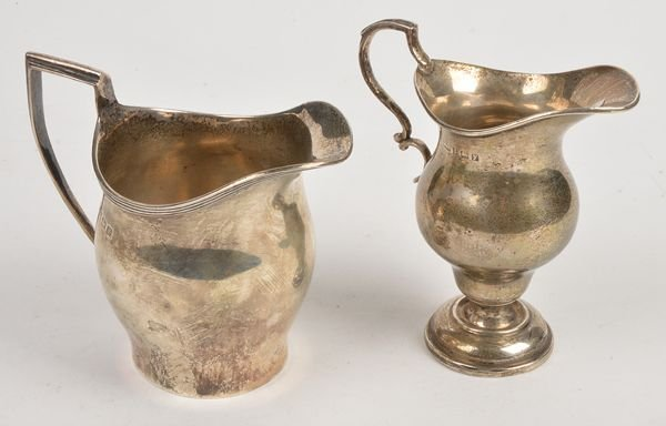 A silver baluster cream jug by S. Blanckensee  Son