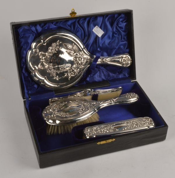 A matched silver mounted five piece dressing table