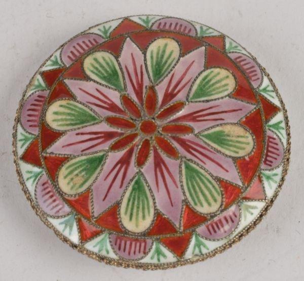 A silver coloured and enamel circular powder compa