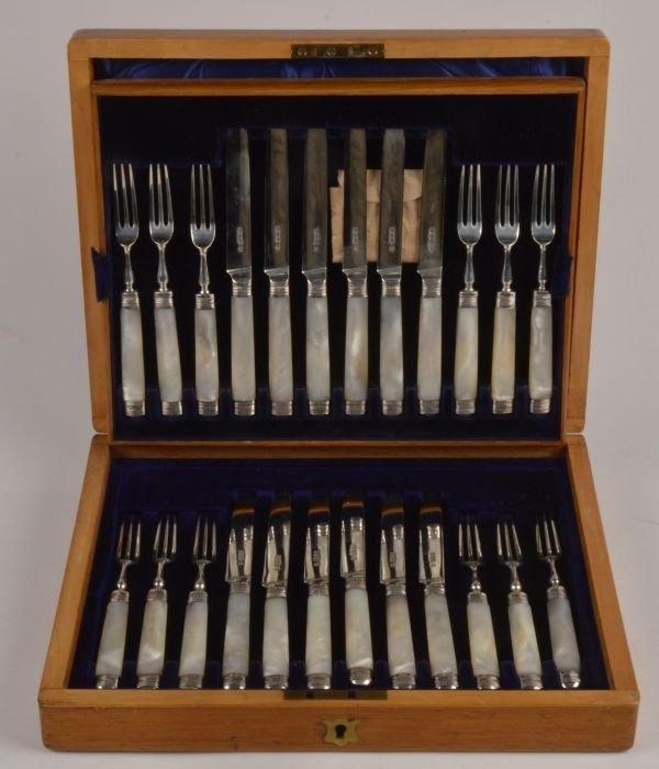 A cased set of twelve Edwardian silver fruit knive