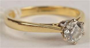 An 18ct gold single stone diamond ring, the brilli