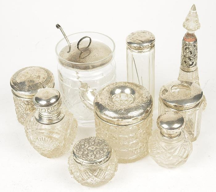 A collection of assorted cut glass bottles with si