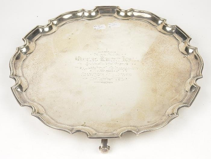 A silver shaped circular salver by Adie Brothers L