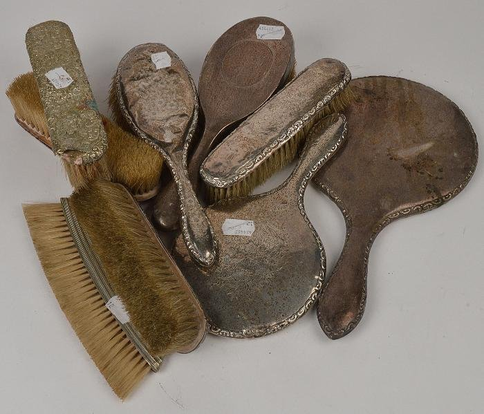 A collection of silver mounted dressing items,  to