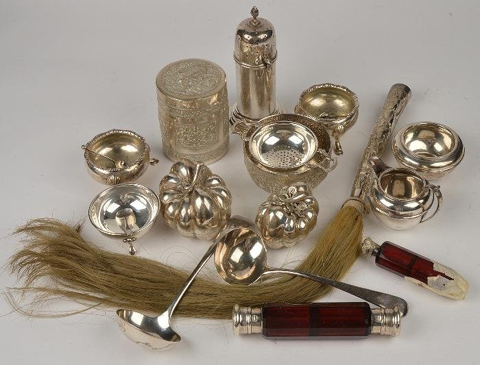 A collection of silver and silver coloured items,