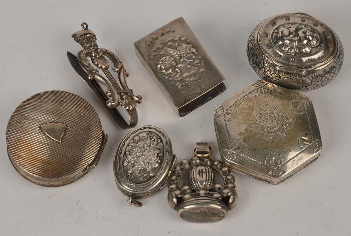 A collection of small silver and silver coloured i