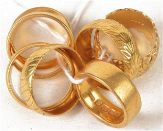 A 22 carat gold wedding band,  finger size N; six