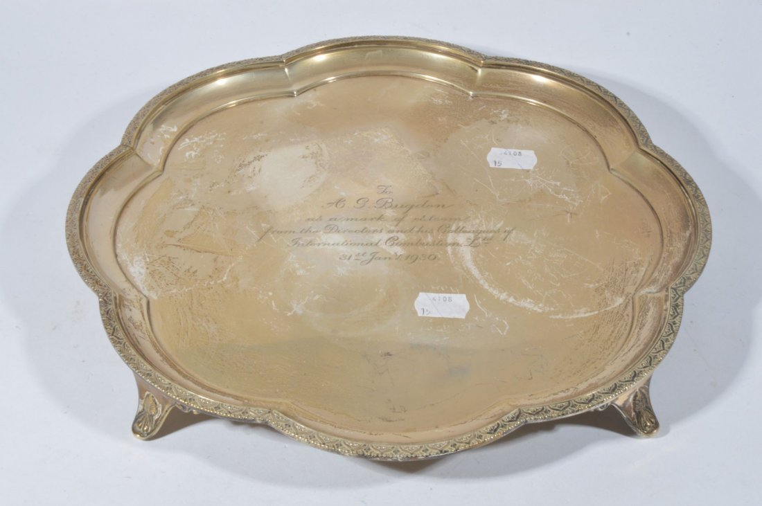 A silver salver or lobed shape with engraved folia
