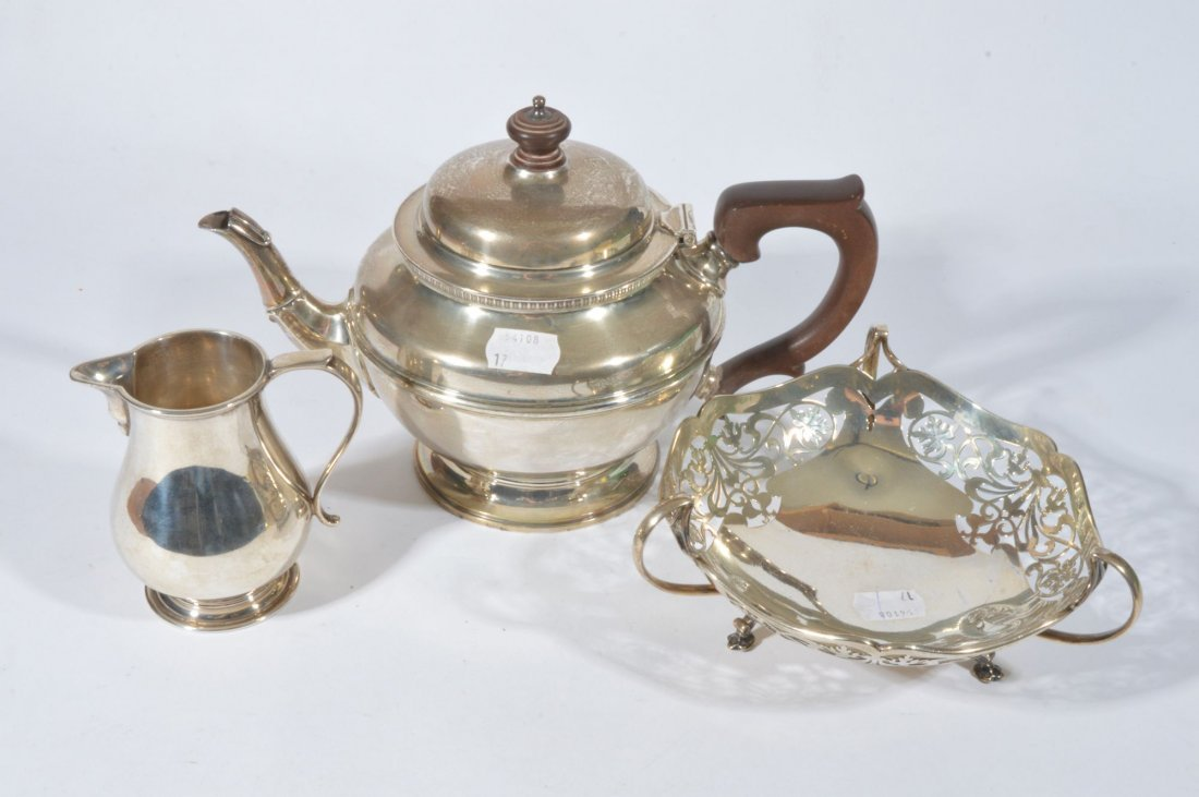 A silver teapot, of circular form, Elkington & Co