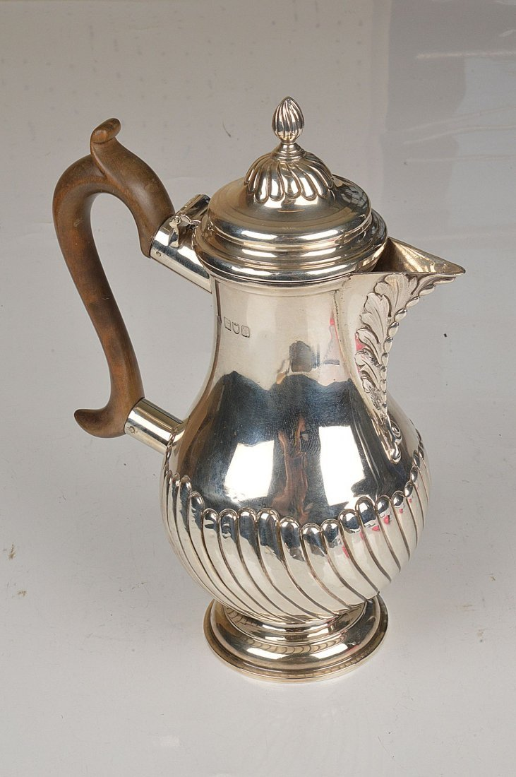 A late Victorian silver baluster hot water jug, ma