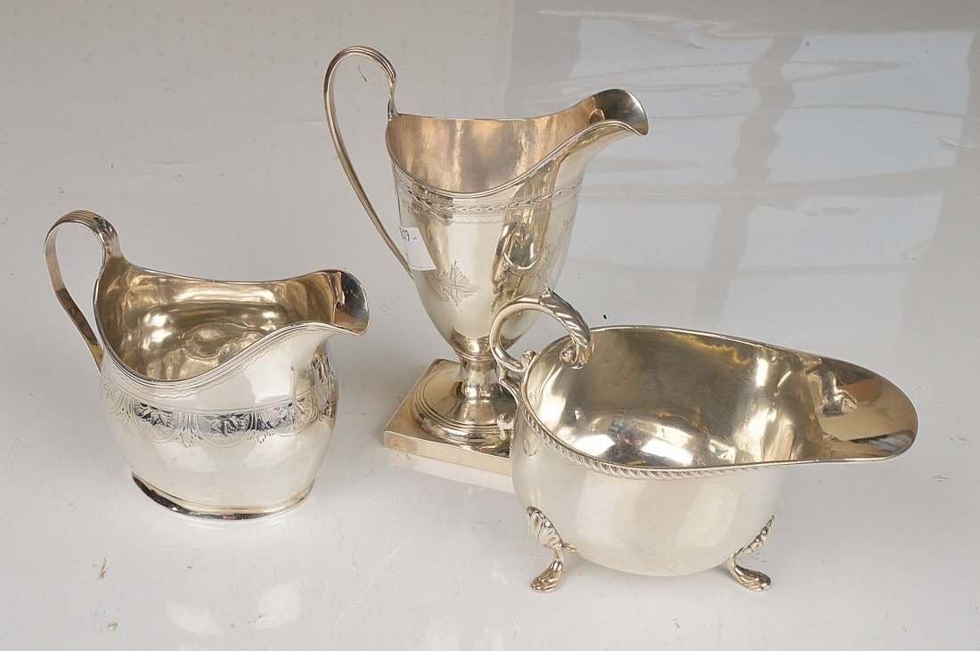 A George III silver oval baluster cream jug by Pet