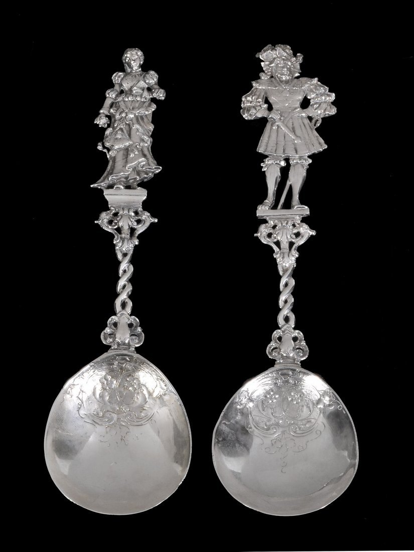 A pair of Dutch silver embossed spoons, import mar