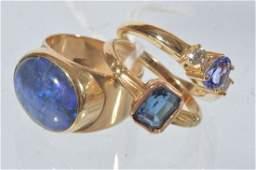 A three stone tanzanite and diamond ring, mount st
