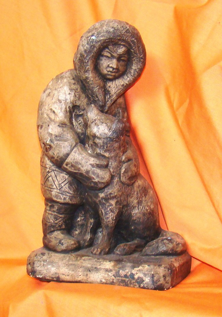 "Signed ""Eskimo & Dog"", 13 ½"" tall by 8"" wide"