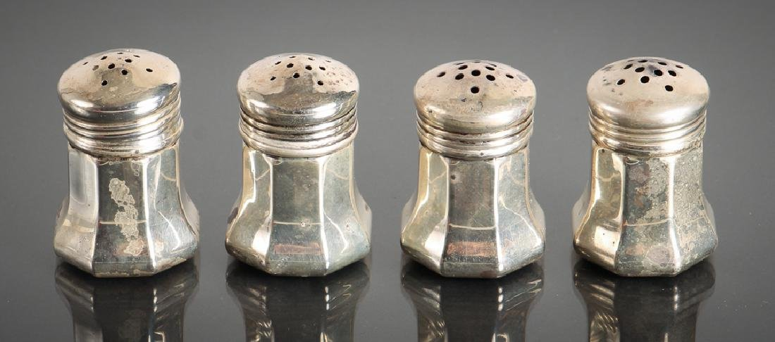 Cased set of Cartier silver miniature S&P shakers