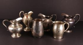 Six Sterling Silver Golf Trophy Pitchers
