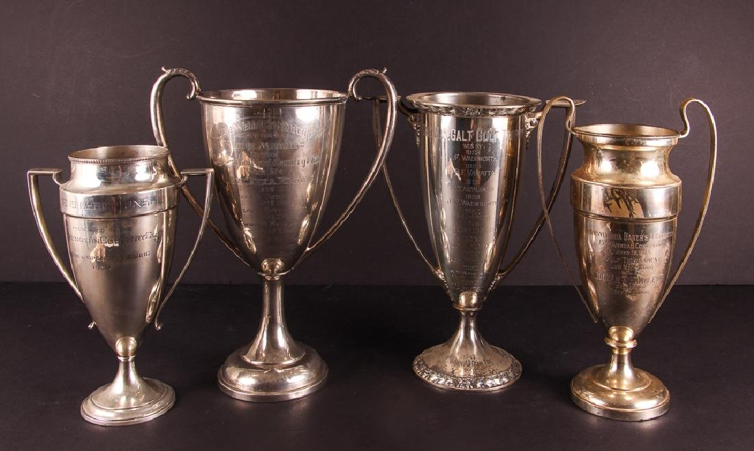 Four Large Sterling Silver Golf Trophies