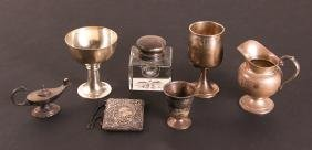 Eight Sterling Golf Trophies or Related Items