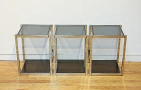 Three chrome and smoked glass side tables