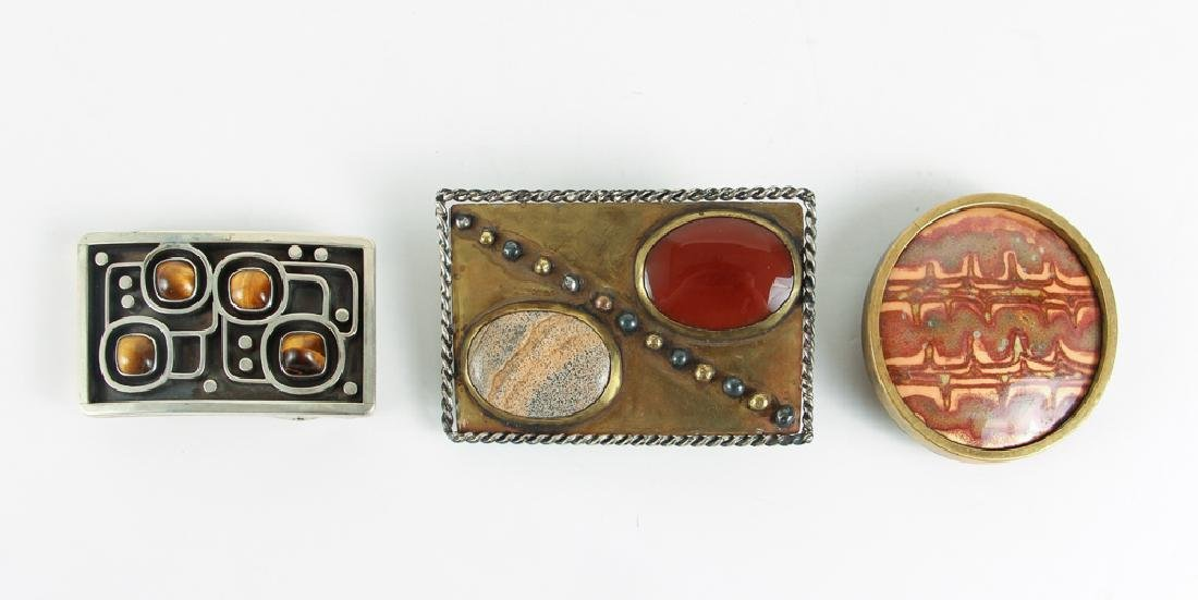 Three James Frappe Belt Buckles