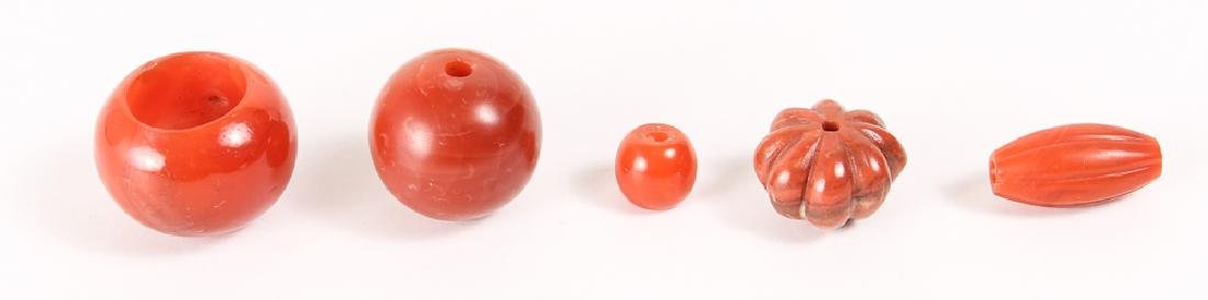 Group of Carnelian and Jade Beads - 7