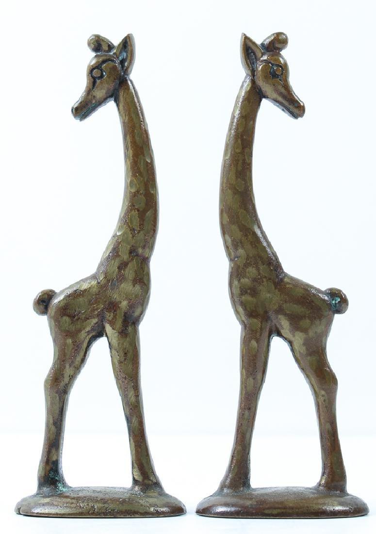 Pair of whimsical Bronze Giraffes