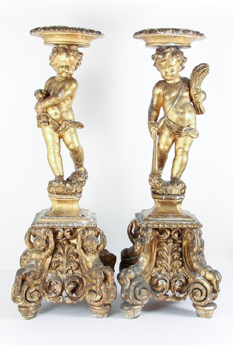 Pair of vigorously carved European Large gilded Cherub