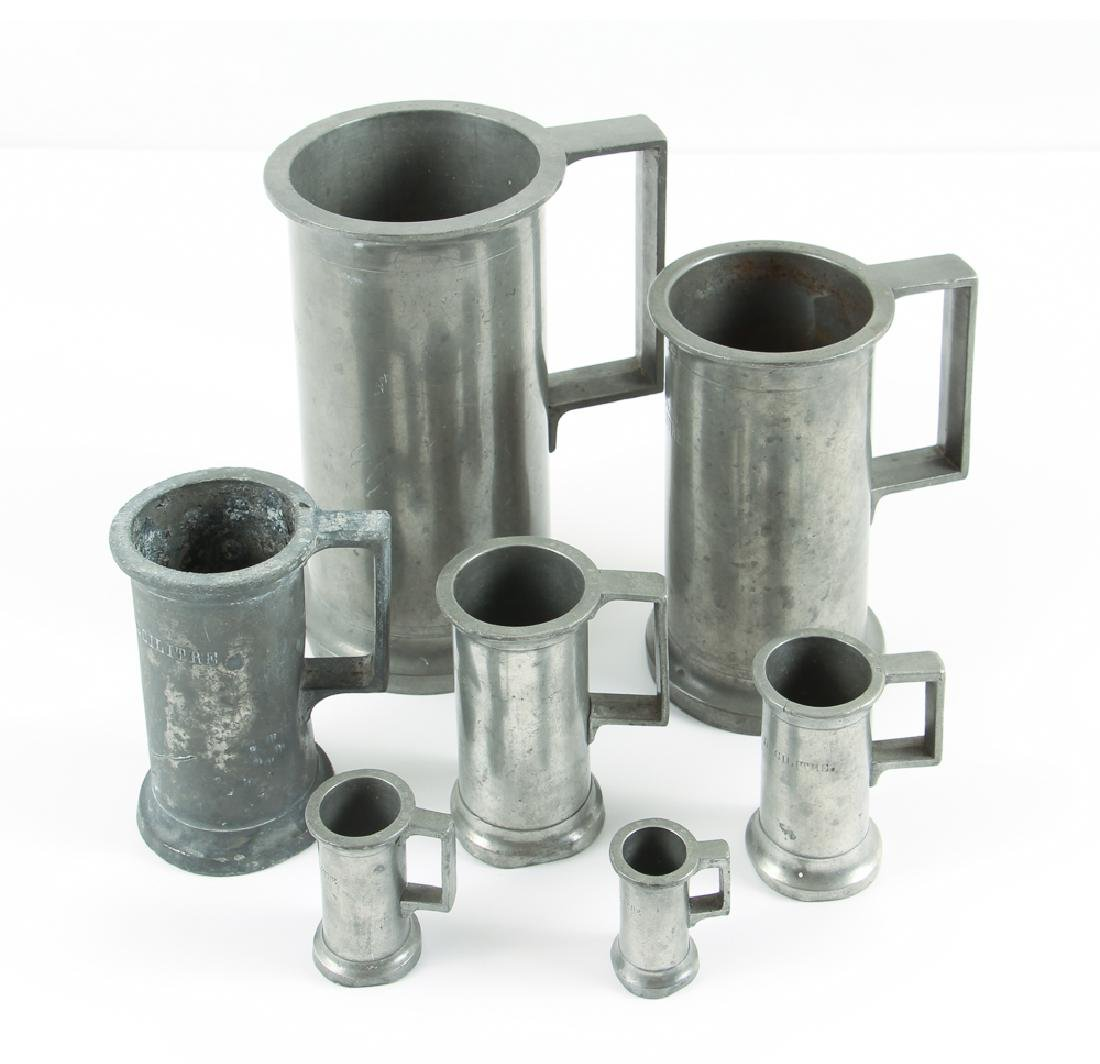 Set of Seven Antique English Pewter Measures