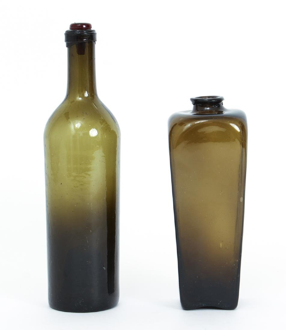 Two Antique Brown Glass Bottles