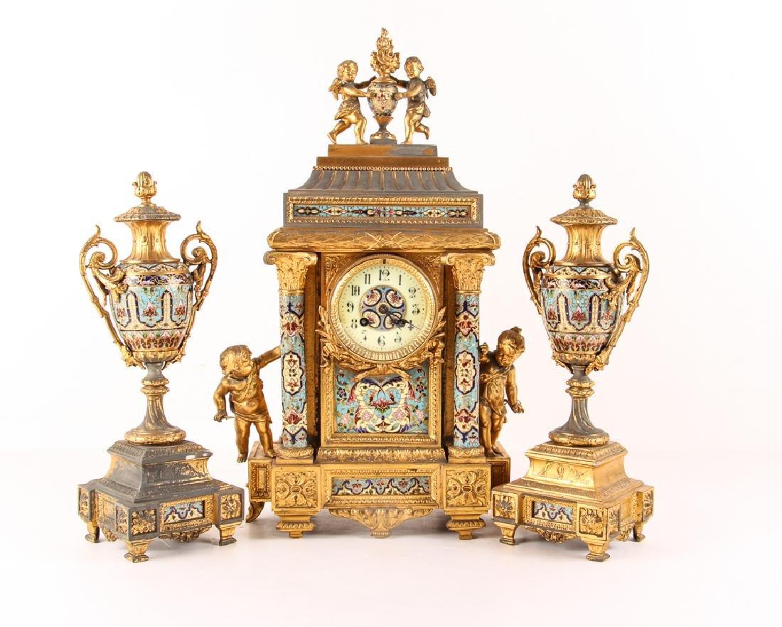 Gilt and Enamel Three Piece Clock and Garniture
