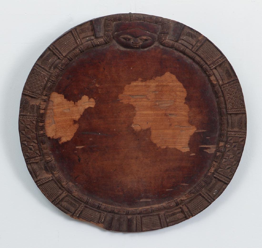 African carved wooden plate
