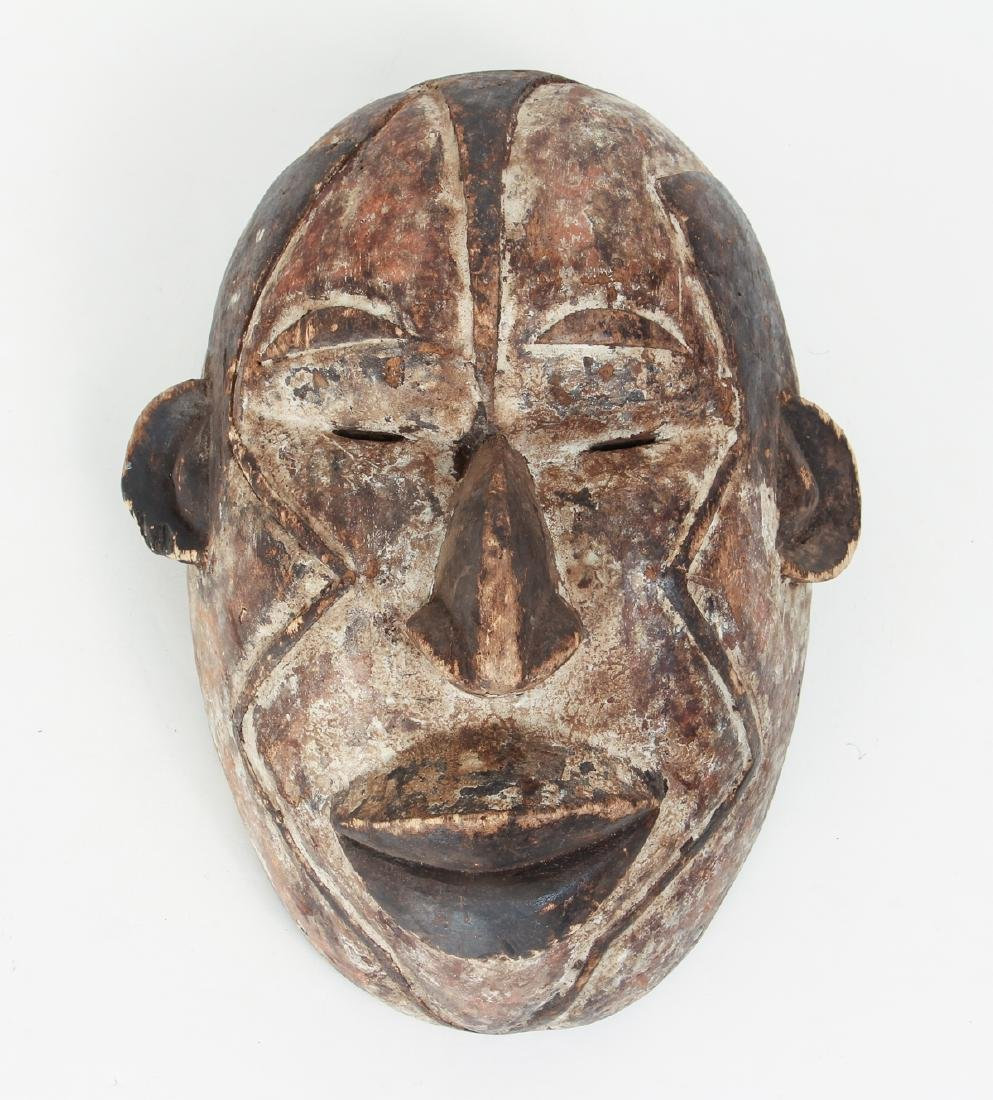 African Mask Laughing with geometric decoration