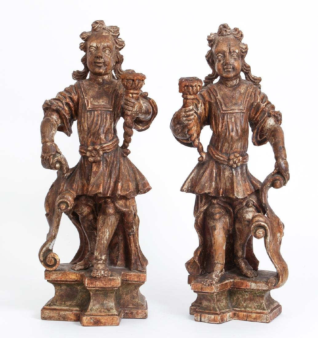 Pair of Antique English Carved Figural Candlesticks