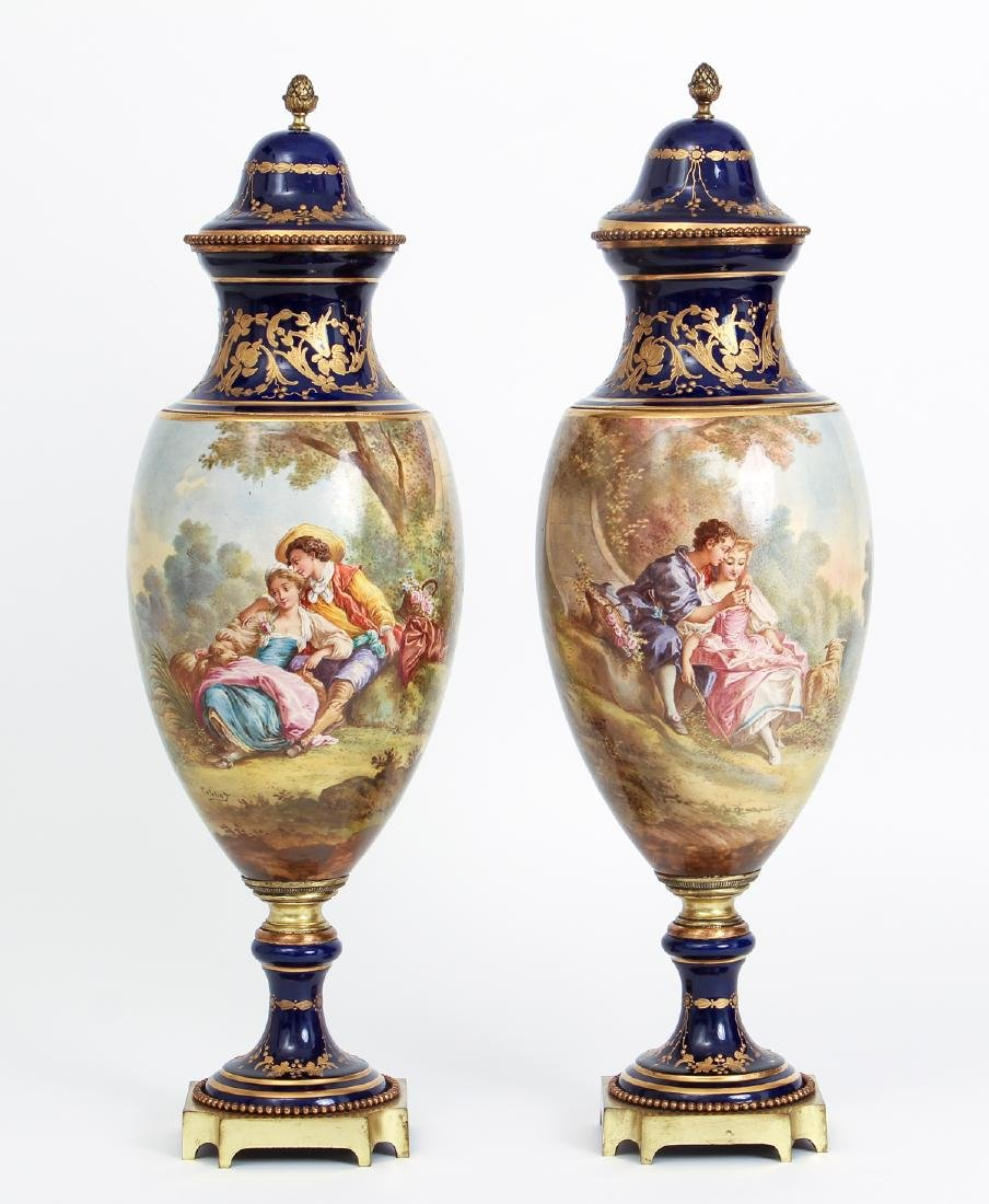 Pair of Sevres Style Lidded Urns Decorated by Collot
