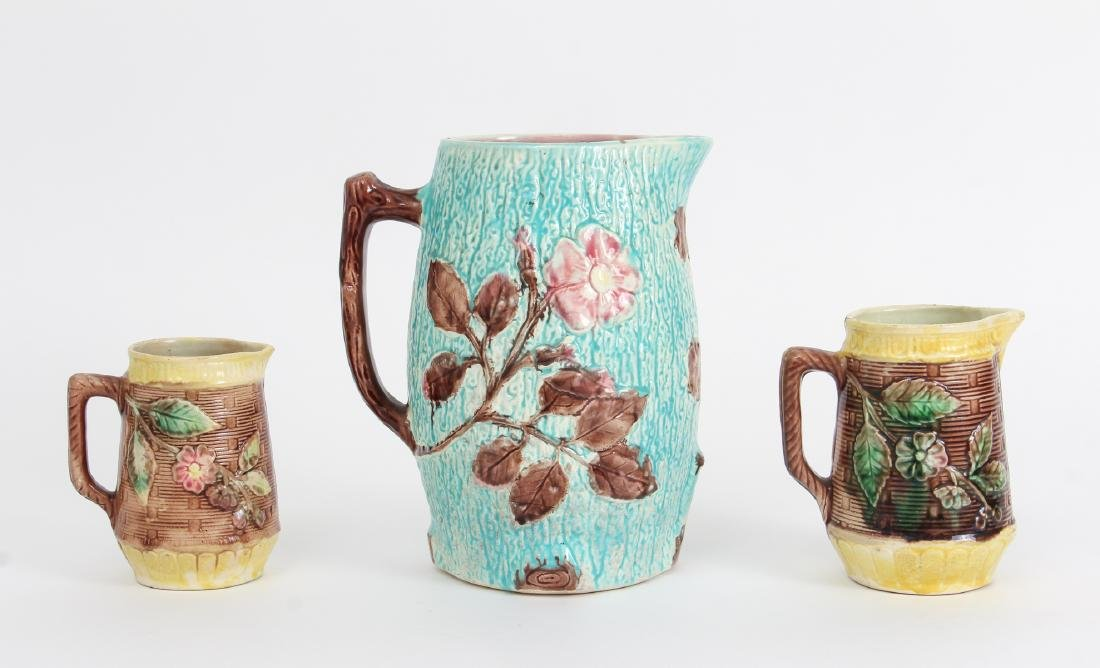 Three Majolica Pitchers of Various Size