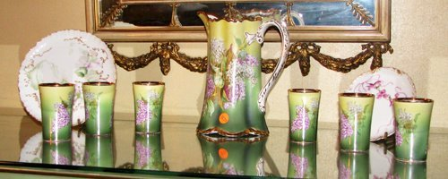 521: 7-pc Pottery Water Set plus two decorated porcelai