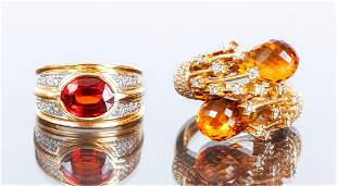 Two 14K Gold and Topaz Rings