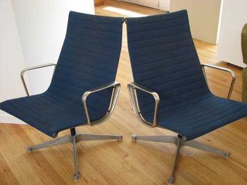22: Pair of Eames Aluminum Group Office Chairs