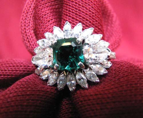 19: Lady's 14k white gold Emerald Ring