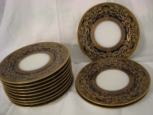 171: 12 Limoges cobalt and gold rim service plates