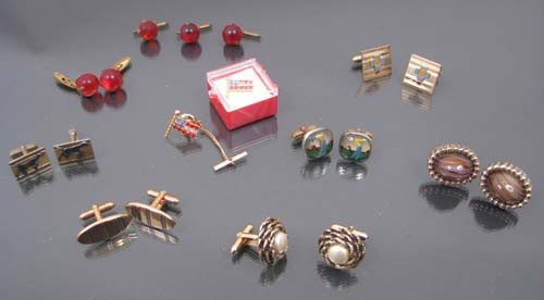 523: 7 pr assorted costume cuff links, two flag pins
