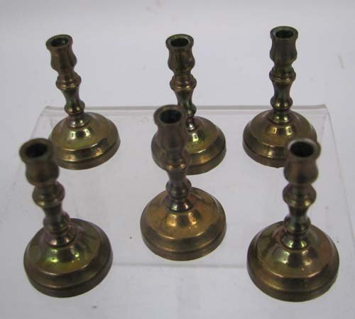 659: Six miniature brass candlesticks